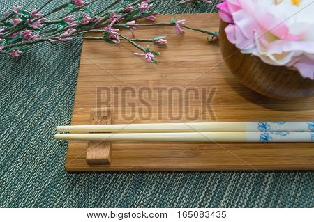 Japanese styled table setting with pink artificial flowers