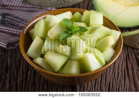 Fresh melon sliced on wooden table. Fresh melon.