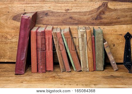 old books on the wooden bookshelf vintage