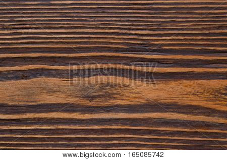 is easily visible texture of dark wood
