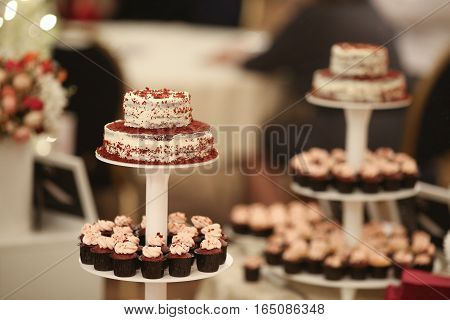 Candy Bar. Delicious sweet buffet with cupcakes. Sweet holiday buffet with cupcakes and other desserts.Table with sweets candies dessert