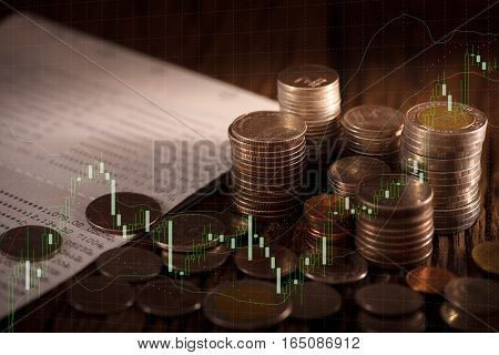 Double exposure of rows of coins and account book, finance and banking concept.