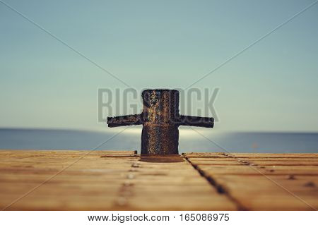 The Mooring Cleats On The Wooden Pier