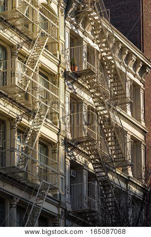 Soho building facades with fire escapes. Manhattan New York City