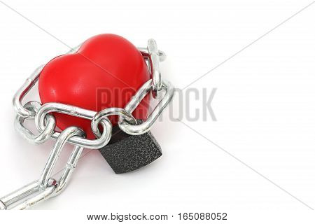 Isolated Red Sponge Heart Locked By Key Chain On White