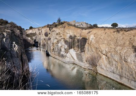 Small granite quarry where groundwater level is emerged. Photo taken in Colmenar Viejo, Madrid, Spain