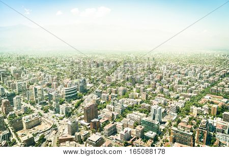Aerial drone view of skyscrapers in downtown district of Santiago de Chile - Modern buildings and skyline in chilean biggest city with green areas and streets intersections - Warm bright color tones