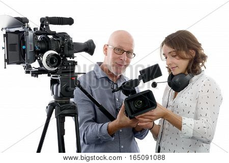 beautiful young woman cameraman and the mature man