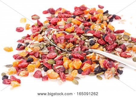 Dried fruits berries and seeds on white background.