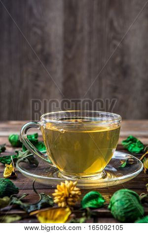 Green tea in clear cup with slop out droplets