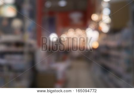 Diy store aisle with shelves and lights out of focus.