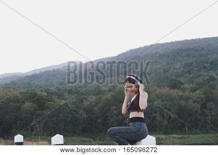 Fitness, Sport And Healthy Lifestyle Concept - Happy Teenage Woman Or Sportswoman With Earphones Out