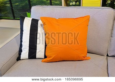 Modern Cozy Sofa with Orange with Black and White Decorative Pillow.
