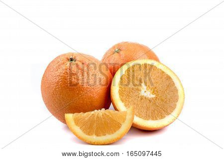 A selection of oranges, sliced and whole