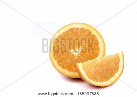 A half and a segment of an orange