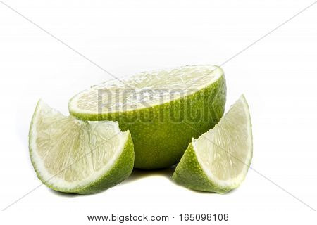 A sliced lime isolated on a white background