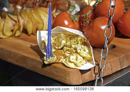 tortellini stuffed with cheese in a creamy tomato and parmesan cheese sauce . street Food Version