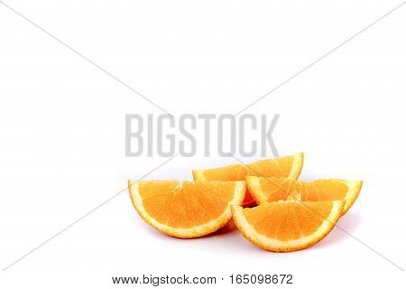 Several slices of orange isolated on white