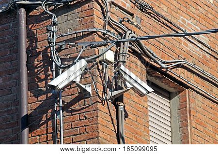 CCTV camera. Security camera on the wall. Private property protection.