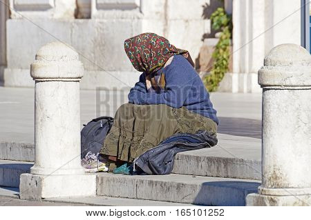 Rome, Italy - 24 March 2016 : Homeless people, like pictured ones, can be seen almost on every corner of every street in the center of all the big cities