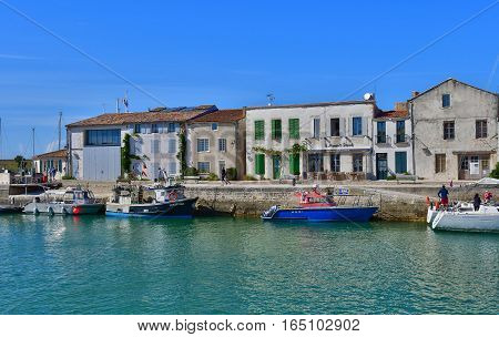 Saint Martin de Re France - september 25 2016 : the picturesque village and boat in the port