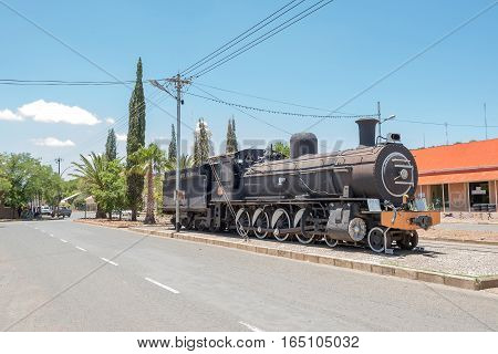FAURESMITH SOUTH AFRICA - DECEMBER 31 2016: A steam locomotive in Fauresmith one of only three towns on earth where the railway line runs down the centre of the main road