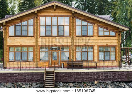 Country house in the forest. Guest-house with pier at the lake. Wooden two-story house
