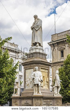 Monument to Leonardo Da Vinci on Piazza Della Scala in Milan Italy. Built in 1872 sculptor Pietro Magni. Statue of Leonardo on a pedestal. At the foot of pedestal stand his four favorite students