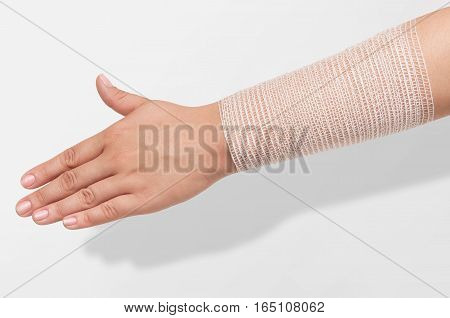 hand professionally wrapped in an elastic bandage