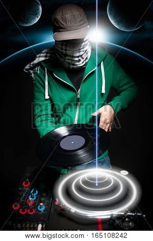 Club Dj at black background in green hoodie