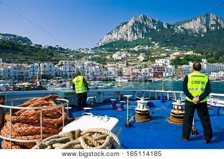 Capri Italy - March 7 2008: The Marina Grande harbor seen from an arriving ferryboat.