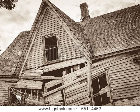 Collapsing wooden house in rural prince edward island