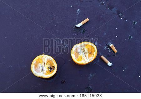 Many cigarette smoked in the crowd, in many countries, smoking is prohibited and encourages a healthy lifestyle and cessation of smoking