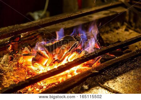Ignite The Coals On The Grill For Cooking Bbq.