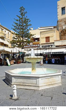 CHANIA, CRETE - SEPTEMBER 16, 2016 - Fountain in the Pl El Venizelou square with shops and restaurants to the rear Chania Crete Greece Europe, September 16, 2016.