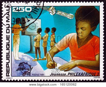 MALI - CIRCA 1985: a stamp printed in Mali shows Education and Telecommunications circa 1985
