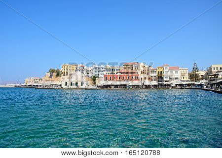 CHANIA, CRETE - SEPTEMBER 16, 2016 - View across the inner harbour towards the mosque and waterfront buildings Chania Crete Greece Europe, September 16, 2016.