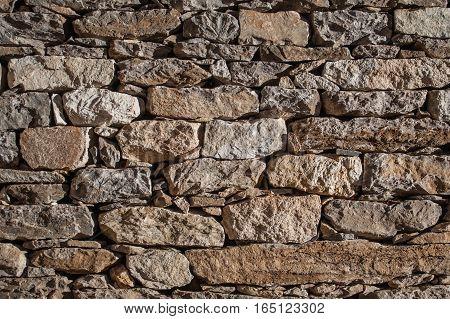 Brick wall background. Old broken bricks close up