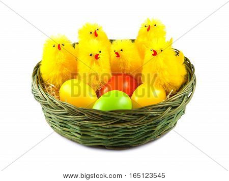 Easter Eggs and Chickens in basket on white background