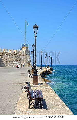 CHANIA, CRETE - SEPTEMBER 16, 2016 - Tourists walking along the quayside with the Maritime museum to the left Chania Crete Greece Europe, September 16, 2016.