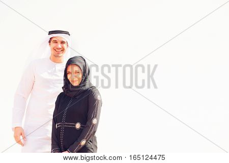 young arabian couple posing in the desert