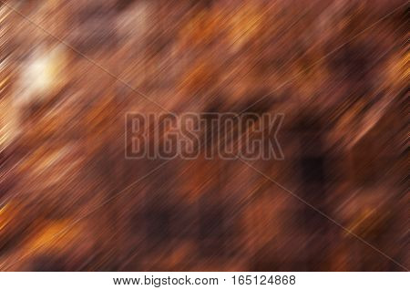 A copper and rust colored abstract background motion blur.