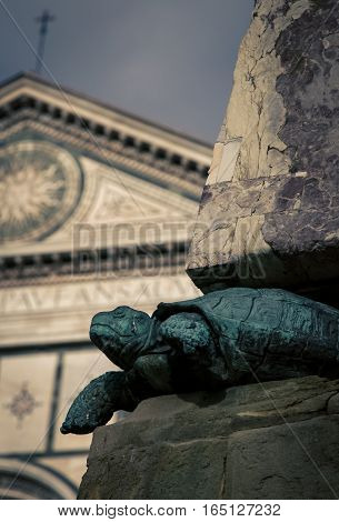 Turtle statue at a church yard  in Florence Italy