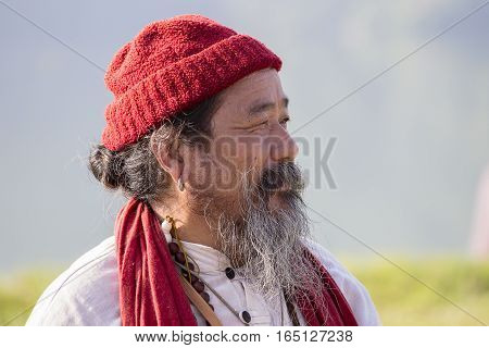 POKHARA NEPAL - OCTOBER 07 2016 : Tibetan Lama conducts classes with sunsurfers people on meditation and yoga near the lake