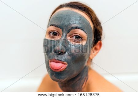 Mask Of Clay On The Girl's Funny Face