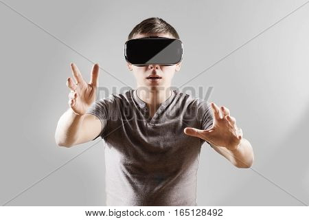 Young man in virtual reality vr glasses.