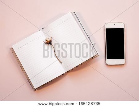flat lay photo of pink workspace desk with smartphone and notebook with copy space background, minimal style, girly