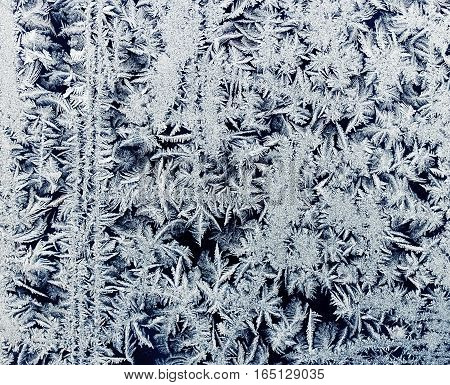 beautiful background from a frosty pattern on glass winter