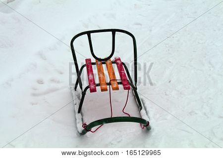 Child's sled. Winter brought along with snow and fun activities for children. Sledge, a favorite form of transport for children in winter.