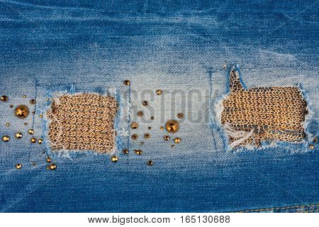 Texture of denim fabric with gold threads inlaid rhinestones. With space for your text